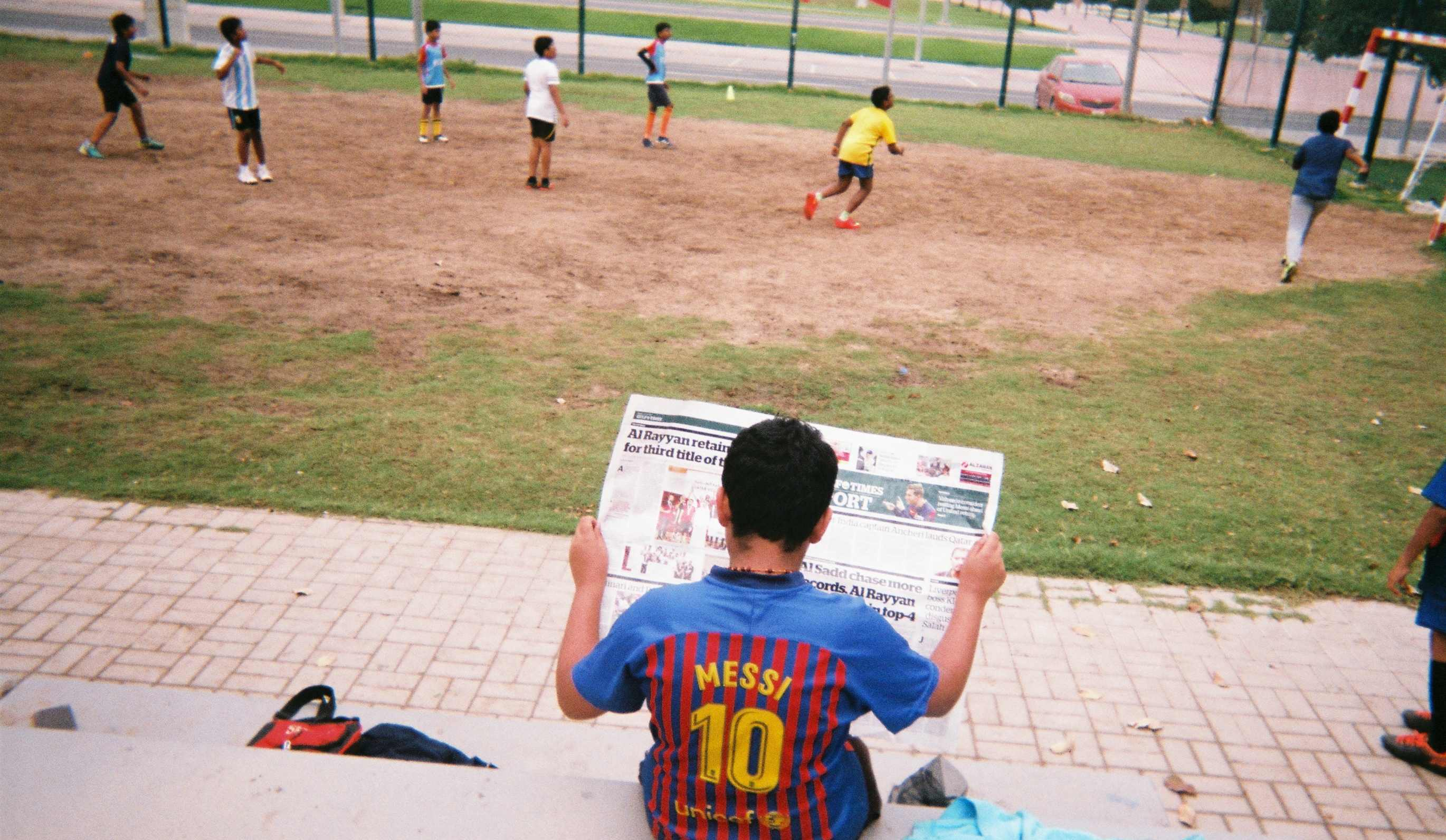 The photographs show the intimate realities of Qatari football culture from the perspective of workers, fans, journalists, coaches and both grassroots and professional players.
