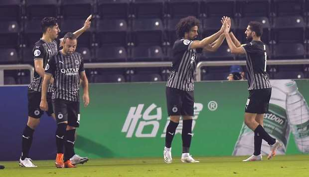Al Sadd's players celebrate a goal during AFC Champions League group stage