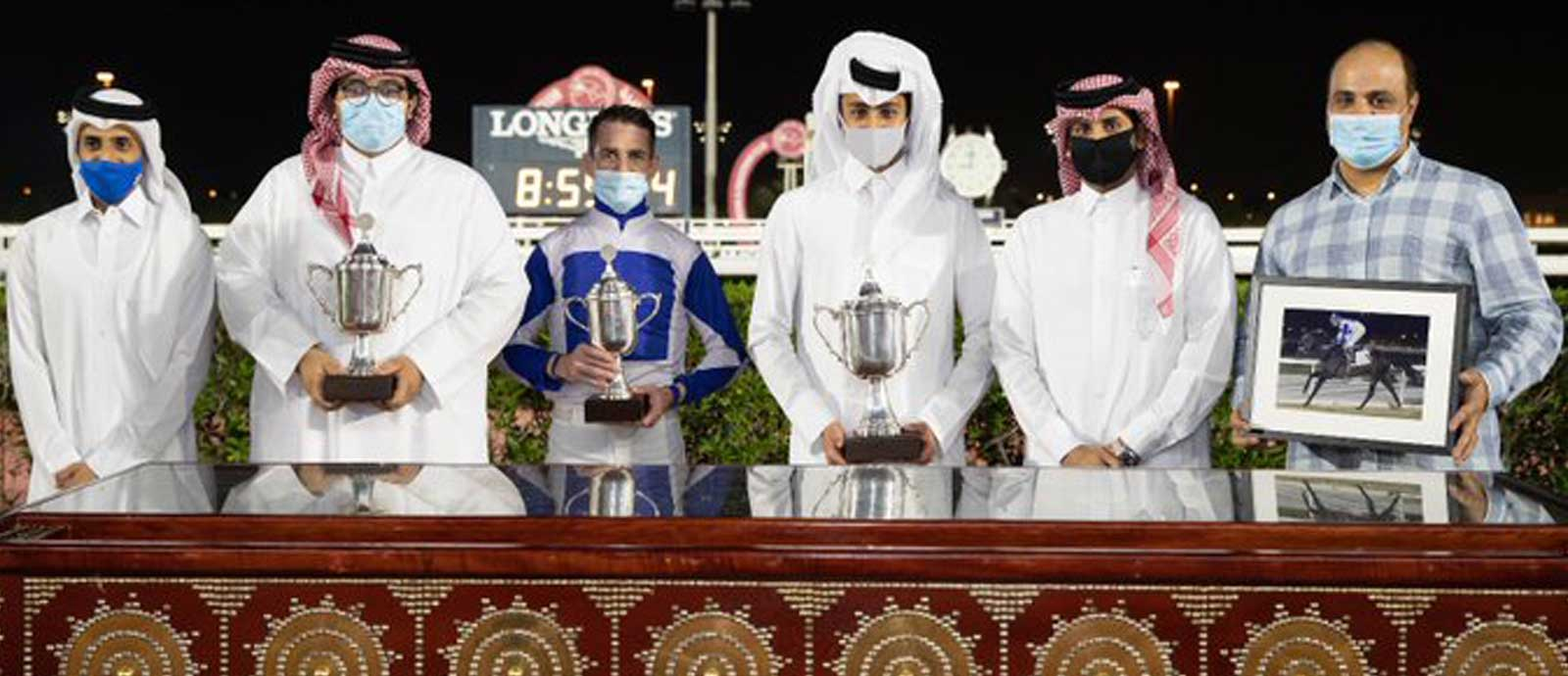 Khalid al-Khalifa Qatar Racing and Equestrian Club Racing manager Mohamed Khalid al-Khalifa (second from right) with the winners of Wathnan Cup